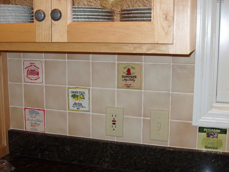 Tiles painted with wine labels, installed